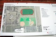 Architect's sketches of the new practice track and field facility north of Baldwin High School. The BHS soccer field will fit inside the track.