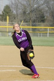 Baldwin High School senior Alex Zordel delivers a pitch during the Bulldogs' doubleheader Tuesday.