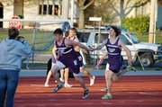 Baldwin High School senior Andy Thurlow hands the baton to sophomore Josh Hoffman during the boys' 400-meter relay Friday.
