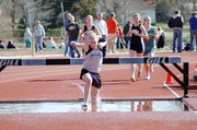 Baldwin High School senior Corinna Papps takes a big step in the water barrier as she leads the 2,000-meter steeplechase Friday. Papps won the race and came within two seconds of the school record.