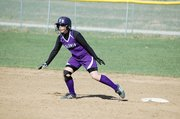 Baldwin High School freshman Kaysha Green heads for third base during the Bulldogs' win over Wellsville.