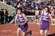 Baldwin High School freshman Tosh Mihesuah, left, begins his leg of the boys' 3,200-meter run Friday after taking the baton from sophomore Carson Barnes.