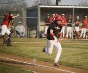 Dylan Caywood hustles down the first-base line for a bunt single during Tonganoxie High's 8-7 win over Jeff West on April 7.