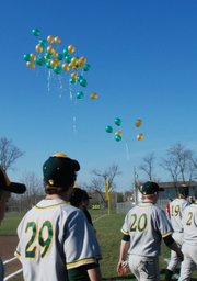 Balloons were released into the sky after the national anthem was sung, concluding the dedication of Eberth Field.