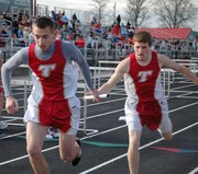 Tommy Heskett takes the baton from teammate Joel Dunning during the 4x800 relay race. The Chieftains finished second with a time of 9:34.21.