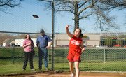Jo Kissinger throws the discuss a personal best record of 80 feet 9 inches during the Tonganoxie Middle School track meet Thursday.