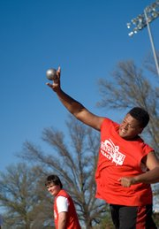Ty Barton, Tonganoxie MIddle School eighth-grader, throws the shot put. He finished second in the event at the TMS dual.