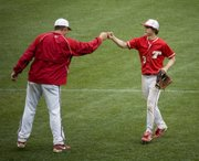 Dylan Caywood is congratulated by Tonganoxie High assistant baseball coach Mitch Loomis following the Chieftains' 13-6 win against Basehor-Linwood in the fifth-place game of the Butch Foster Memorial Baseball Classic on Saturday. Caywood was three for four in the victory with three runs scored and one RBI.