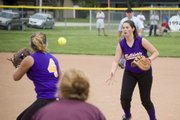 McLouth first baseman Kaley Patterson flips the softball to second baseman Jessie Troupe on Monday at Silver Lake.