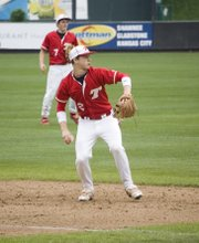 Tonganoxie third baseman Ethan Lorance prepares to gun a throw to first at CommunityAmerica Ballpark.
