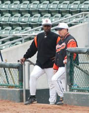 Bonner Springs High School assistant baseball coach Butch Foster, Jr., left, and head coach Rick Moulin converse during the Braves' game against Tonganoxie on Friday at the Butch Foster Memorial Baseball Classic, a tournament named for Foster's father.