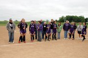 Baldwin High School softball players celebrated senior night Tuesday. Here the six seniors are honored as they stand with their parents.