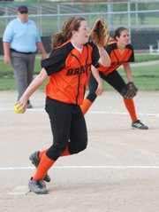 Bonner Springs' Kelly Chastain fires a pitch during the first game of a doubleheader Monday against Basehor-Linwood. BLHS won both games.