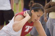 Roni Grizzle prepares to throw the shot put for Tonganoxie High on Wednesday, May 13 at the Kaw Valley League Meet in Kansas City, Kan. A THS senior, Grizzle won KVL titles in the shot, javelin and discus as the Chieftains finished third in the league standings.