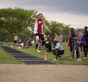 Dylan Scates flies through the air on a long-jump attempt at the KVL Meet. Although he fouled and didn't place in that event, he won the triple jump with a personal record of 42 feet, 2 inches.