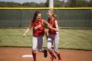 Shortstop Kaitlyn Wolken and second baseman Brooklyn Kerbaugh share a laugh after they collided at second base but still got a double play.