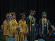 Valedictorians, from left, Heather Carmitchel, Jessyka Coulter, Amber Jeannin, Thomas Pedroza and Lucas Turner receive medals at the 2009 Basehor-Linwood High School commencement ceremony.