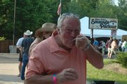Mike Horsch, of Lee's Summit, Mo., enjoys a sample of the Bacon Explosion.
