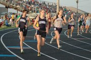 Jamie Orth and Kaya Riemann run in the girls 800-meters.
