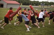Tonganoxie High linemen battle during drills on June 3 at THS football camp.