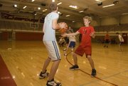 Conner Kietzmann gets in defensive position on Friday at Tonganoxie High freshman basketball camp.