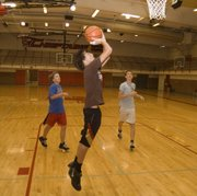 Justin Stockman lays the ball in during a fast-break drill on Friday at Tonganoxie freshman basketball camp.