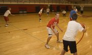 Tyler Hall and other Tonganoxie High freshman basketball campers learn their proper defensive spots during a shell drill on Friday at THS.