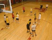 Players set up a half-court set on Thursday at Tonganoxie High girls basketball camp. Seventeen players attended the four-day camp from June 8-11 at THS.