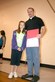 Rachel Maurer was a semi-finalist in fourth grade for her essay on her father, Andrew.