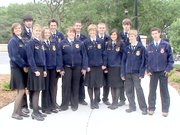 Tonganoxie's FFA chapter traveled to the state convention in Manhattan on May 27. Pictured FFA members, from left, are: (front row) Hannah Gee, Rachel Bieniecki, Katelyn Colgrove, Hilary Saathoff, Alex Hauk, Hunter Lohr, Luke Dyleski, (back row) Nikki Gee, Daniel Holton, Tayler Miles, Shawn Kesinger, Andrew Bouza and Richie Ridihalgh.