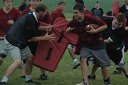 Grady Proffitt tries to get to the edge at EHS football camp.