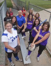 Pictured are the members of this year's All-Area Softball Team. Surrounding coach Jill Larson-Bradney of Perry-Lecompton are, clockwise from front left: Courtney Kasson, Perry-Lecompton; Rosie Hull and Maggie Hull, Free State; Hailie Rae, Ottawa; Lauren Himpel, Tonganoxie; Alex Zordel, Baldwin; and Kendall Patterson, Missy Rome, Lezley Lawson and Kaley Patterson, McLouth.