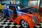 This $65,000 street rod patterned after a 1939 Ford is for sale at Wagner's. This car is new, with a flame-inspired paint job, but has a classic feel to it and features coil over suspension, an aluminum radiator and a custom leather ostrich interior. Scott Wagner said that only 20 percent of the classic cars in the shop are sold to Bonner Springs residents, the rest all over the world.