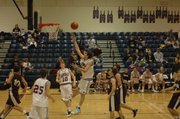Justin Ballock drives in for a layup against Silver Lake early in the season. Ballock averaged 15 points and five rebounds a game for the EHS boys basketball team. Ballock also was a first team all-league pick. 