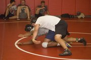 Jonas Myers bears down on his opponent on Thursday night at Tonganoxie High.