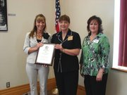 Gayle Runnels (middle) presents Holly Sebree-Gripka (left) and Michelle Meyer with their award for the Medicine Store.