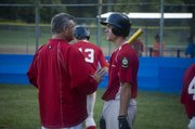 Post 41 coach Gary Wagner talks with Kyle Newton in the middle of the fourth inning on Tuesday night at Leavenworth. Newton went 5-for-5 in Tonganoxie's 9-8 defeat of Easton in the Post 23 League championship game.