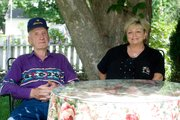 John and Connie Anderson outside their Leavenworth home earlier this summer.