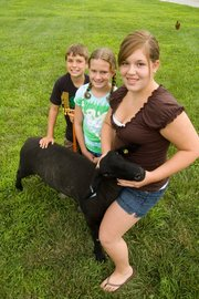 Drake, Abigail and Hannah Pray will be participating in the Leavenworth County Fair this year. The three Pray children are members of the Happy Helpers 4-H club. The siblings posed with the market lamb Hannah will show at the fair.