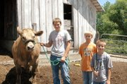 Jake Phillips, Justin Phillips and Joe Phillips are pictured from left. All three brothers will be submitting projects in the upcoming Leavenworth County Fair.