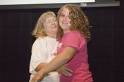 Lisa Elliott gives Lindsey Fatherley, Elliott Heart Award recipient, a hug on Thursday night at Tonganoxie High's Chieftain Power Awards Night.