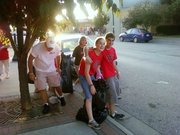 Members of the West Haven Baptist Church pick up trash after the Leavenworth County Fair Parade Tuesday.
