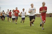 Members of the Tonganoxie High soccer team run through conditioning drills on Monday afternoon at THS.