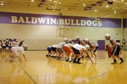 Baldwin High School's football team practiced in the BHS gymnasium Monday evening. Lightning forced the team inside that morning, but there was still standing water on the field Monday night.