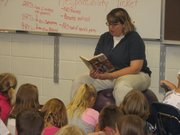 Michelle Ablard reads a book to Basehor Elementary fifth-grade students Aug. 13 during their first day of school. Officials in the Basehor-Linwood School District said the start to the 2009-2010 school year had been quite positive.