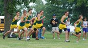 The Basehor-Linwood varsity boys fire off from the starting line at the Bobcat Invitational. They brought home first place in the team standings, matching a feat that the BLHS girls also accomplished.