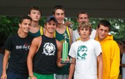 The Basehor-Linwood varsity boys pose with their first-place team trophy at the Bobcat Invitational.