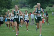 Beth Reichenberger, left, and Lacey Erickson, right, run in De Soto's first cross country meet of the year at Anderson County. Reichenberger finished sixth with a time of 17:04 and Erickson finished first with a time of 16:03. The De Soto girls finished second overall.