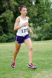 Baldwin High School freshman Sienna Durr runs the Anderson County cross country course last Thursday. Durr placed second in the 4-kilometer race to lead the Bulldogs to the team title.