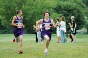 Baldwin High School junior Tony Weiss, right, sprints to the finish while sophomore Brian Wright looks off in the direction of the spectators. Weiss won the 5-kilometer race while Wright finished runner-up as the Bulldogs placed second as a team.